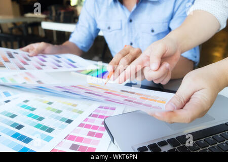 Graphic design and color swatches and pens on a desk. Architectural drawing with work tools and accessories. - Stock Photo