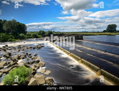 Broken Scar Dam At River Tees Against Sky - Stock Photo