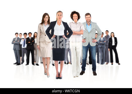 Composite image of business team looking at camera on white background - Stock Photo