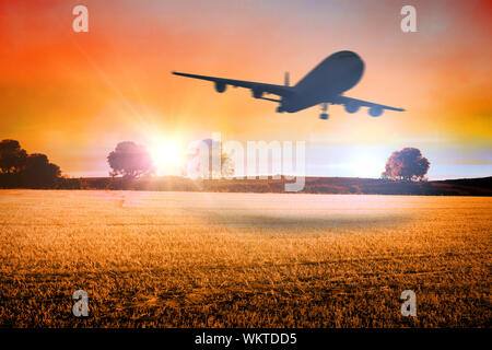 Composite image of airplane taking off against countryside scene - Stock Photo