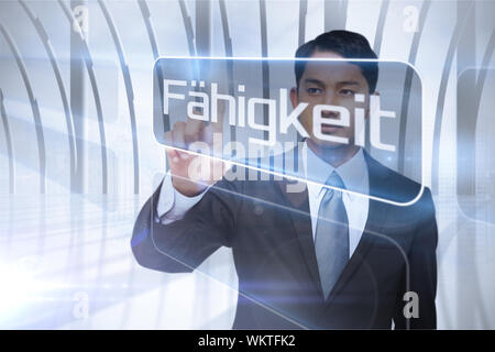 Businessman presenting the word ability in german against white room with large window overlooking city - Stock Photo