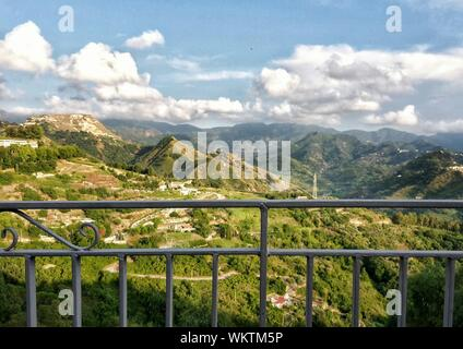 Scenic View Of Green Landscape Against Sky Seen From Balcony - Stock Photo