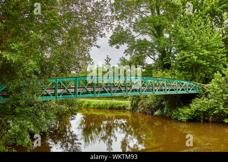 Image of a foot bridge over the Canal d'ille et Rance - Stock Photo