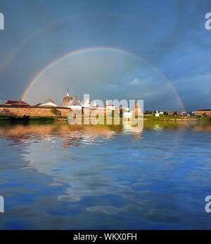 Rainbow over the Monastery. Spaso-Preobrazhenskiy solovetsky monastery. Solovetsky Archipelago, The White Sea, Korelia, Northern Russia. - Stock Photo