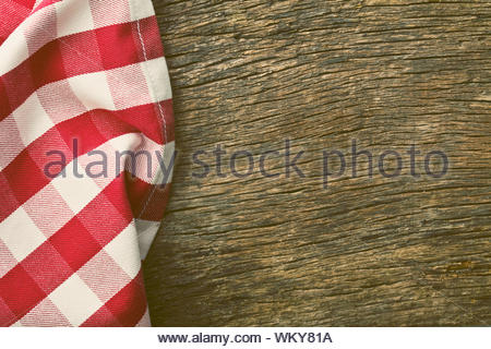 red tablecloth over old wooden table - Stock Photo