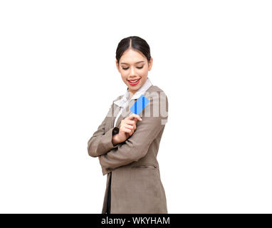 Young Businesswoman Holding Credit Card Against White Background - Stock Photo