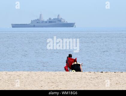 Norfolk, Virginia, USA. 04 September 2019. The Royal Netherlands Navy guided-missile frigate HNLMS De Ruyter departs Naval Station Norfolk ahead of Hurricane Dorian, which is forecasted to bring high winds and heavy rains to the region September 4, 2019 in Norfolk, Virginia. All ships at the massive Navy base are heading out to sea where they are safer from the approaching storm. Credit: Spencer R. Layne/U.S. Navy/Alamy Live News - Stock Photo