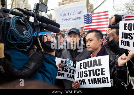 Protest in Brooklyn in support of NYPD officer Peter Liang who was convicted of manslaughter and official misconduct for the shooting of Akai Gurley. - Stock Photo