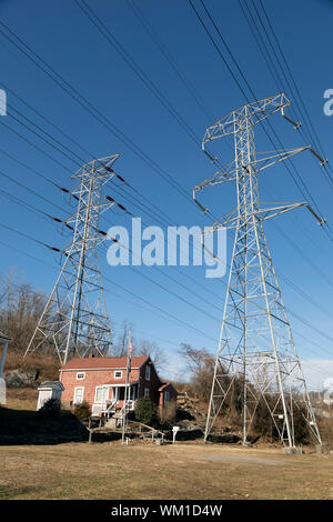A house located under high tension power lines in Yonkers, New York. - Stock Photo