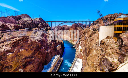 The Mike O'Callaghan–Pat Tillman Memorial Bridge that crosses the Colorado river at the Hoover Dam and connecting the states of Nevada and Arizona USA - Stock Photo