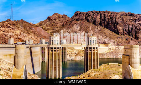 The four Intake Towers that supply the water from Lake Mead to the Power plant Turbines of the Hoover Dam hydroelectric power station at NV and AZ - Stock Photo
