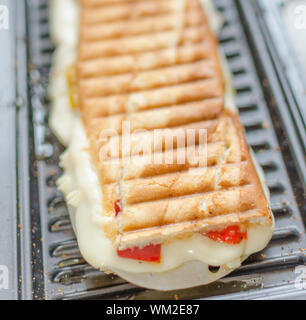 Panini sandwiches italien with paprica, cheese, eggs and ham - Stock Photo