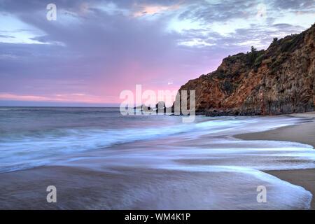 Sunset over the beach at Crescent Bay in Laguna Beach, California, USA in summer - Stock Photo