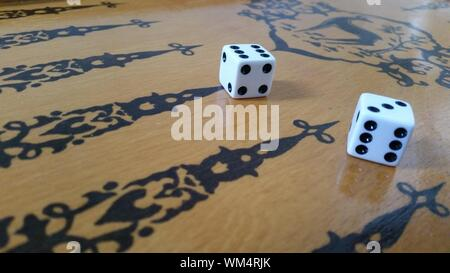 Close-up Of Dice On Craps Table - Stock Photo