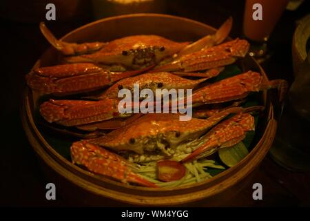 High Angle View Of Steamed Crabs In Container - Stock Photo