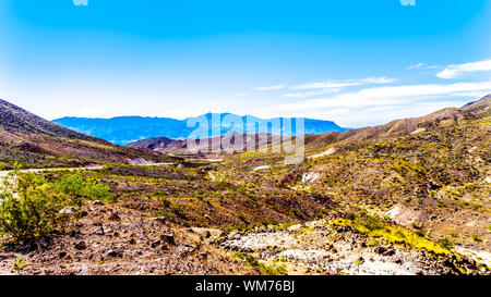 Northshore Road SR167 in Lake Mead National Recreation Area in the semi desert landscape with colorful mountains between Boulder City and Overton. USA - Stock Photo