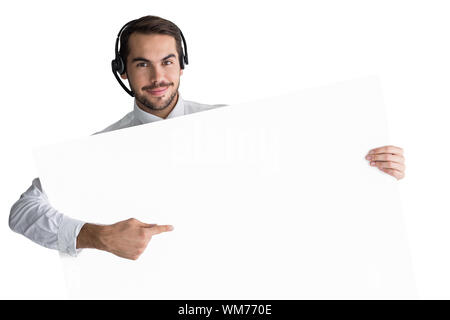 Businessman with headphone showing sign to camera on white background - Stock Photo