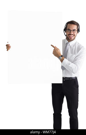 Businessman with headphone pointing sign to camera on white background - Stock Photo