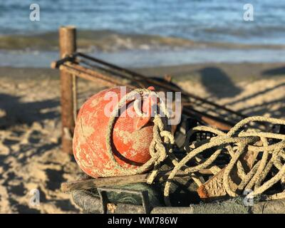 Close-up Of Red Water On Beach - Stock Photo