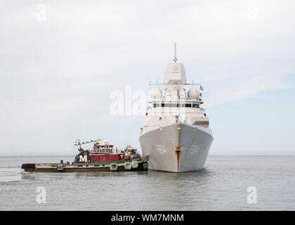 190904-N-IK388-0046 NORFOLK (Sept. 4, 2019) Royal Netherlands Navy guided-missile frigate HNLMS De Ruyter (F804) departs Naval Station Norfolk as Commander, U.S. 2nd Fleet orders U.S. Navy ships and aircraft in the area to sortie on Sept. 4 ahead of Hurricane Dorian, which is forecasted to bring high winds and heavy rains to the East Coast. Ships are being directed to areas in the Atlantic where they are best postured for storm avoidance. (U.S. Navy photo by Mass Communication Specialist 2nd Class Stacy M. Atkins Ricks/Released) - Stock Photo