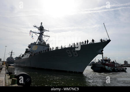 NORFOLK (Sept. 4, 2019) Sailors man the rails of the Arleigh Burke-class guided-missile destroyer USS Forrest Sherman (DDG 98) as the ship gets underway as Commander, U.S. 2nd Fleet orders U.S. Navy ships and aircraft in the area to sortie on Sept. 4, 2019 ahead of Hurricane Dorian, which is forecasted to bring high winds and heavy rain to the East Coast. Ships are being directed to areas in the Atlantic where they are best postured for storm avoidance. (U.S. Navy photo by Mass Communication Specialist 1st Class Joshua D. Sheppard/Released) - Stock Photo