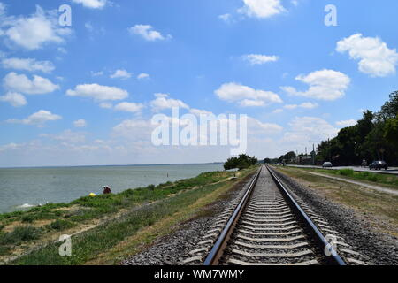 View Of Train Tracks Along The Beach - Stock Photo