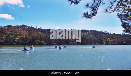 Swan Boats In Lake Against Sky At Love Valley - Stock Photo