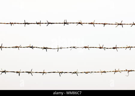 Barbed Wire Fence Against Clear Sky - Stock Photo