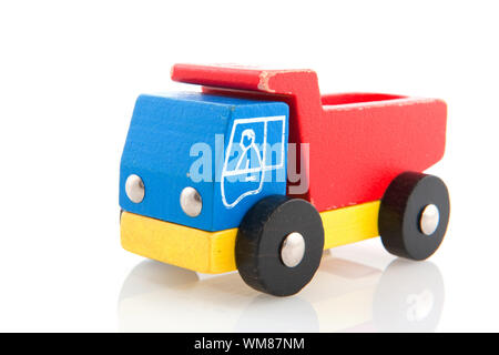 wooden toy truck with driver isolated over white - Stock Photo