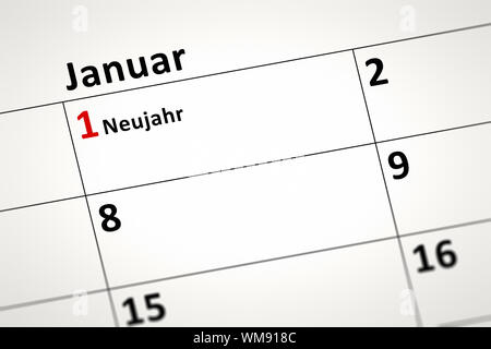 An image of a calendar detail shows January the first New Year in german language - Stock Photo