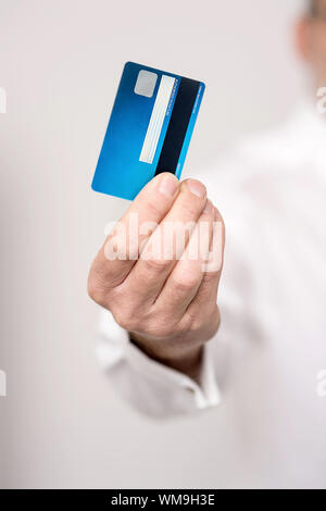 Cropped image of hand showing debit card - Stock Photo