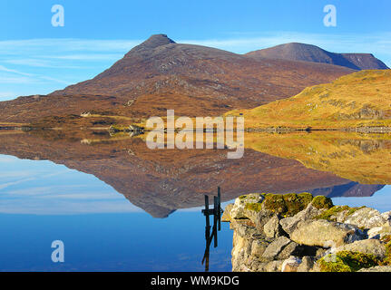 Scenic View Of Lake And Quinag Mountain Against Sky - Stock Photo