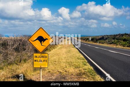 Signboard By Road At Great Ocean Road Against Sky - Stock Photo