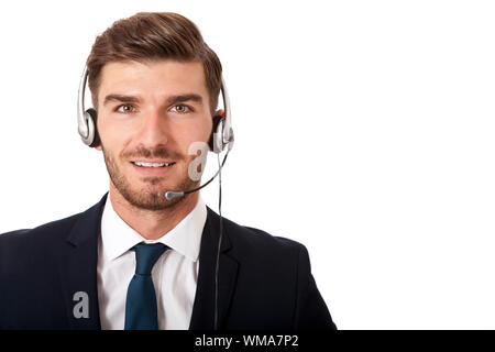 Young bearded handsome man wearing formal business suit and headset with stereo headphones and microphone while smiling at camera, portrait on white - Stock Photo