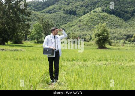 Full Length Of Doctor Standing On Field - Stock Photo