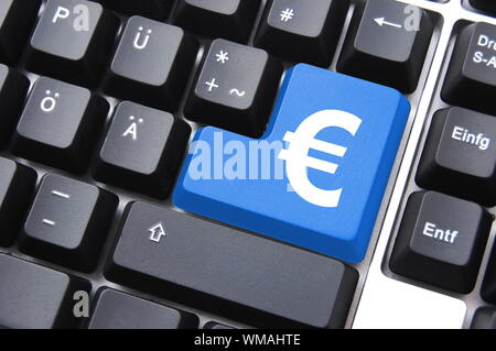 internet or computer business with money button on keyboard - Stock Photo