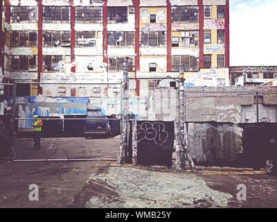 Chainlink Fence In Front Of Factory - Stock Photo