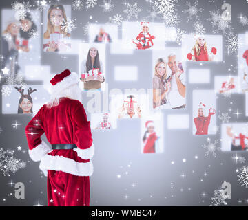 Santa looks away from the camera against grey vignette - Stock Photo