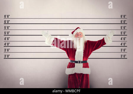 Jolly Santa opens his arms to camera against mug shot background - Stock Photo