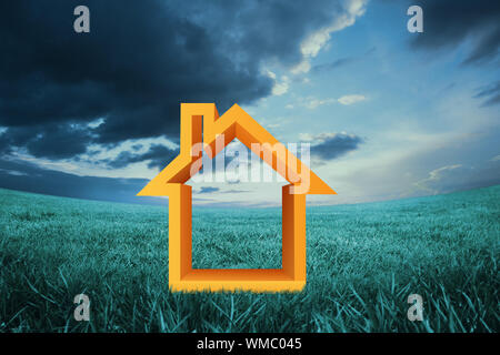House outline against blue sky over green field - Stock Photo