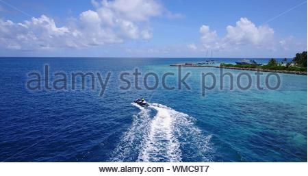 High Angle View Of Man Riding Jet Boat In Sea - Stock Photo