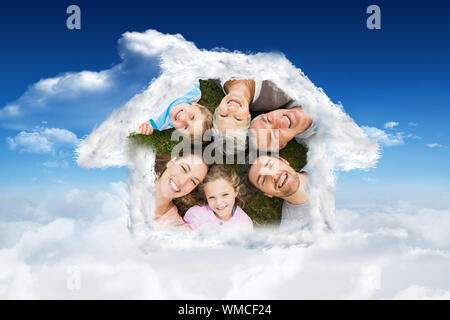 House outline in clouds against bright blue sky with clouds - Stock Photo