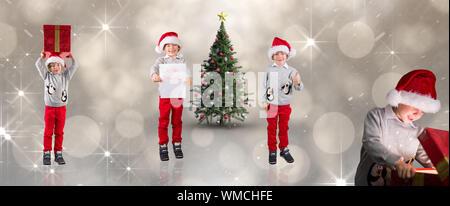 Composite image of different festive boys against shimmering light design on grey - Stock Photo