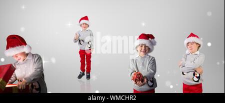 Composite image of different festive boys against grey vignette - Stock Photo