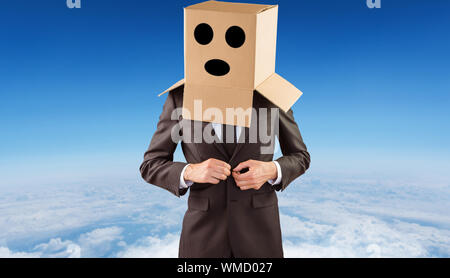 Anonymous businessman buttoning his jacket against blue sky over white clouds - Stock Photo