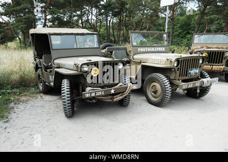 vintage world war 2  military cars parked ready for historical reenactment at 'd-day' Hel festival, in Hel, Pomerania, Poland. - Stock Photo