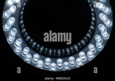 Close-up Of Illuminated White Led Lights Against Black Background - Stock Photo