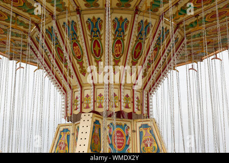 Close up of a swing carousel at a fairground - Stock Photo