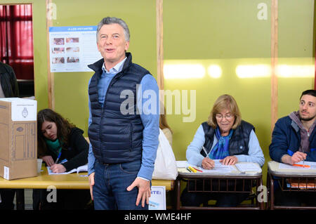 Mauricio Macri, President of Argentina, gives his vote at the presidential primaries in a polling station in Buenos Aires. Eight candidate pairs compete in the area code. However, chances for a possible run-off in December are only envisaged by the duo Mauricio Macri âA Miguel Angel Pichetto and Alberto FernÃndez âA Cristina FernÃndez de Kirchner. In the first round of voting on October 27, the President and Vice-President, 130 deputies, 24 senators and governors in the provinces of Buenos Aires, La Rioja, Catamarca and in the capital are elected. | Usage worldwide - Stock Photo