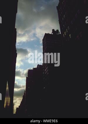 Low Angle View Of Silhouetted Buildings - Stock Photo